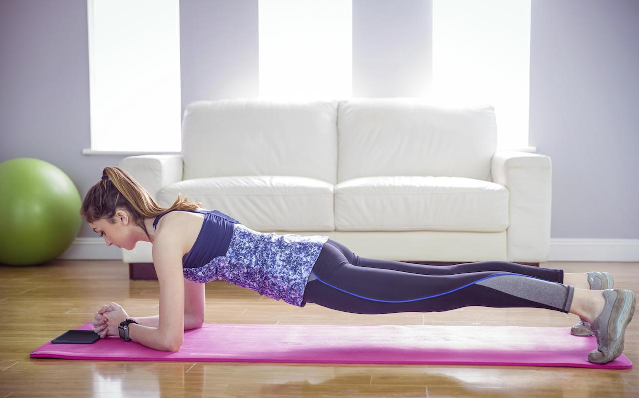 Stay fit and healthy by stretching on a mat