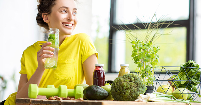 Active8me to detox or not to detox happy woman with detox drink
