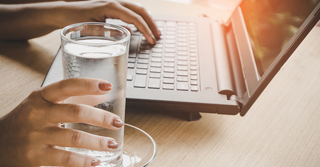 Active8me 8 ways your job is making you fat plus easy fixes glass of water on desk