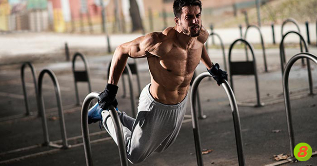 Active8me How Long Should a HIIT Workout Be? Muscly man on bars